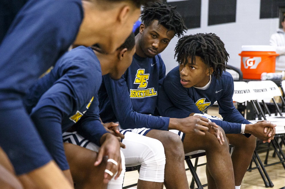Southeast's Terrion Murdix (4) and Southeast's Anthony Fairlee (21) huddle with their teammates during player introductions as the Spartans prepare to take on Mahomet-Syemour during the Class 3A Decatur Eisenhower Sectional semifinals at Eisenhower High School, Wednesday, March 7, 2018, in Decatur, Ill. [Justin L. Fowler/The State Journal-Register]