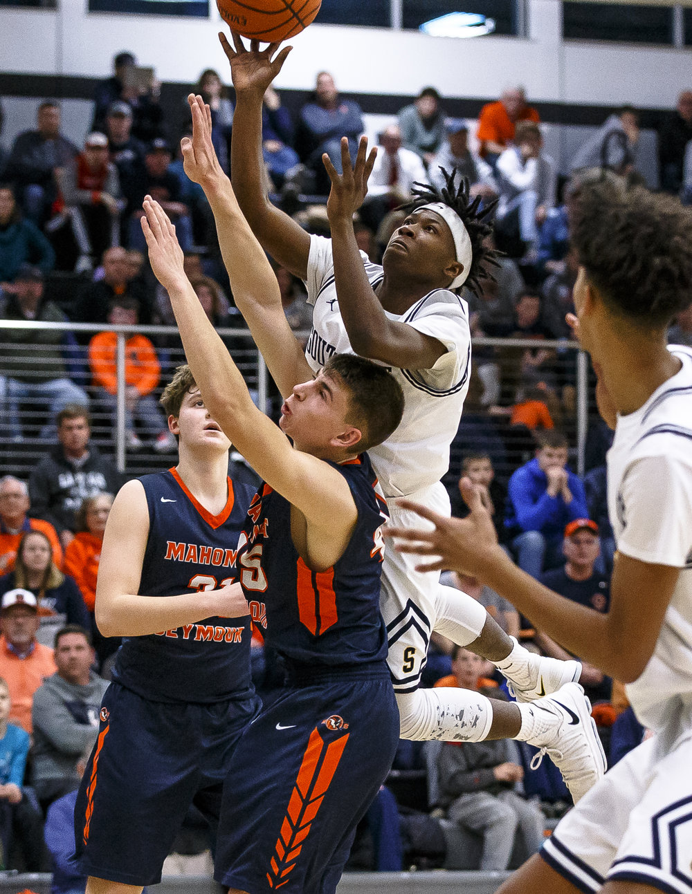 Southeast's Stepheon Sims (32) goes up to the basket against Mahomet-Seymour's Noah Benedict (45) in the second half during the Class 3A Decatur Eisenhower Sectional semifinals at Eisenhower High School, Wednesday, March 7, 2018, in Decatur, Ill. [Justin L. Fowler/The State Journal-Register]