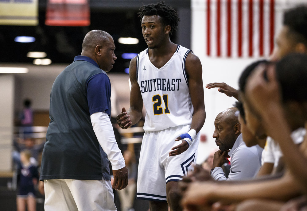Southeast's Anthony Fairlee (21) talks with Southeast boys basketball head coach Lawrence Thomas as he comes off the floor as the Spartans take on Mahomet-Syemour in the second half during the Class 3A Decatur Eisenhower Sectional semifinals at Eisenhower High School, Wednesday, March 7, 2018, in Decatur, Ill. [Justin L. Fowler/The State Journal-Register]