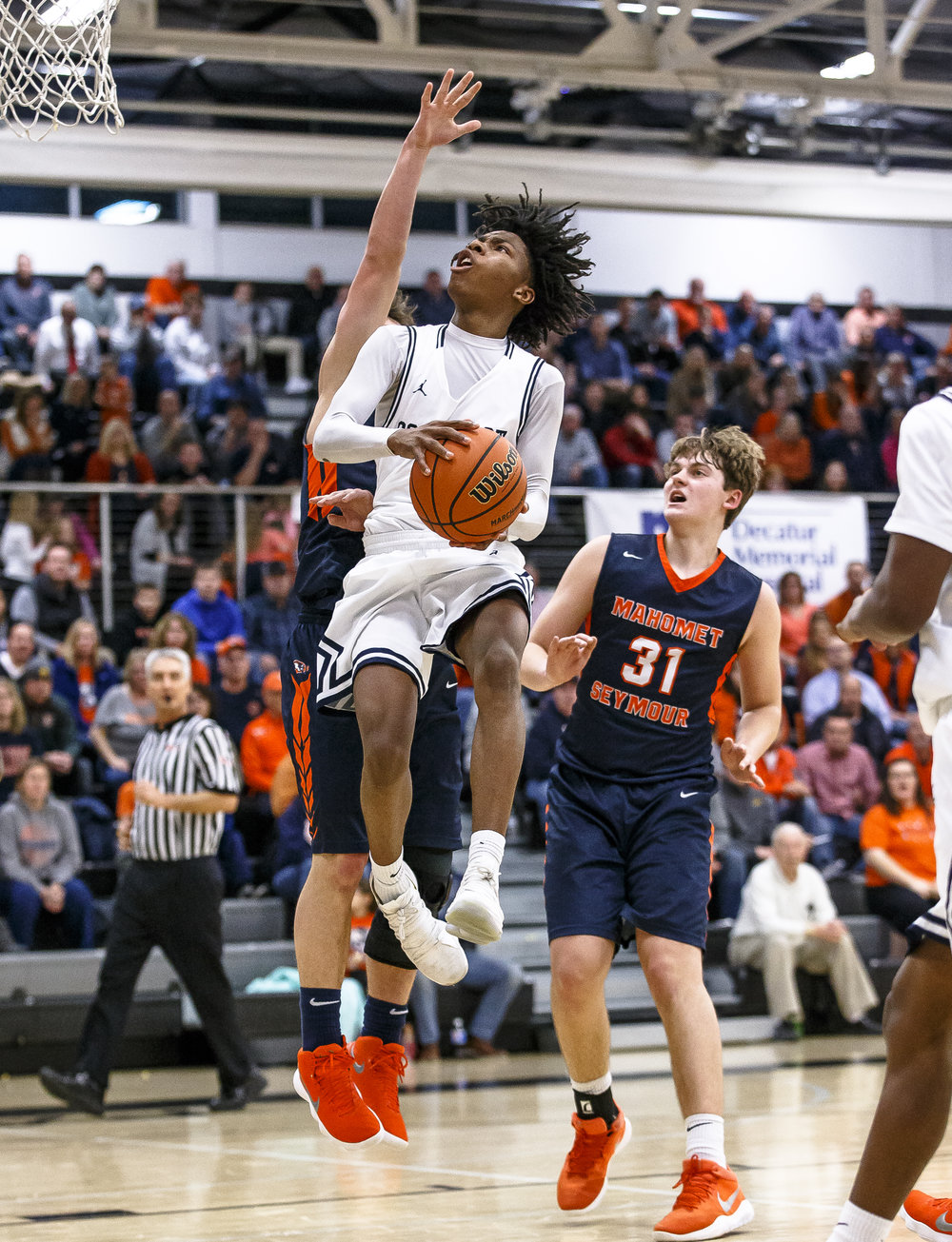 Southeast's Terrion Murdix (4) goes up to the basket against Mahomet-Seymour's Brooks Coetzee (23) in the second half during the Class 3A Decatur Eisenhower Sectional semifinals at Eisenhower High School, Wednesday, March 7, 2018, in Decatur, Ill. [Justin L. Fowler/The State Journal-Register]
