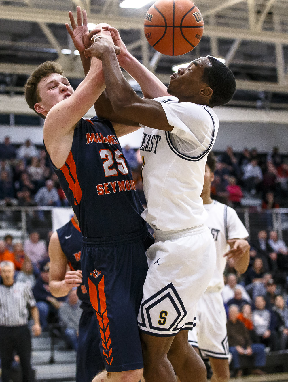 Southeast's Kobe Medley (11) and Mahomet-Seymour's Holt Campion (25) collide as they go for a rebound in the second half during the Class 3A Decatur Eisenhower Sectional semifinals at Eisenhower High School, Wednesday, March 7, 2018, in Decatur, Ill. [Justin L. Fowler/The State Journal-Register]