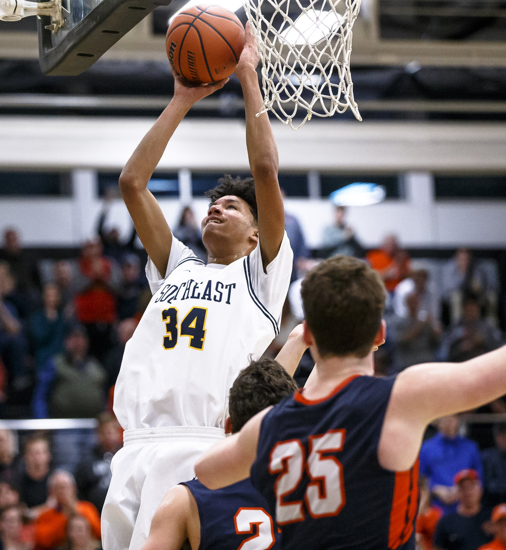Southeast's Michael Tyler (34) goes up for a basket against Mahomet-Syemour in the second half during the Class 3A Decatur Eisenhower Sectional semifinals at Eisenhower High School, Wednesday, March 7, 2018, in Decatur, Ill. [Justin L. Fowler/The State Journal-Register]