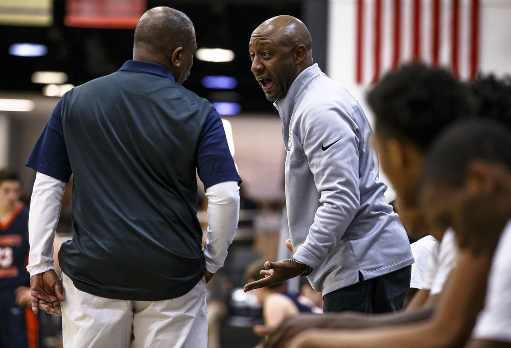 Southeast assistant coach Chuck Shanklin talks with head coach Lawrence Thomas as the Spartans take on Mahomet-Syemour in the second half during the Class 3A Decatur Eisenhower Sectional semifinals at Eisenhower High School, Wednesday, March 7, 2018, in Decatur, Ill. [Justin L. Fowler/The State Journal-Register]