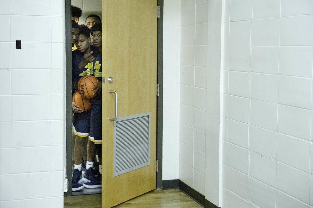 The Southeast Spartans peak out the locker room door before taking on Lanphier during the 3A & Lanphier vs Southeast 3A Decatur Eisenhower Sectional \u2014 The Visual ...