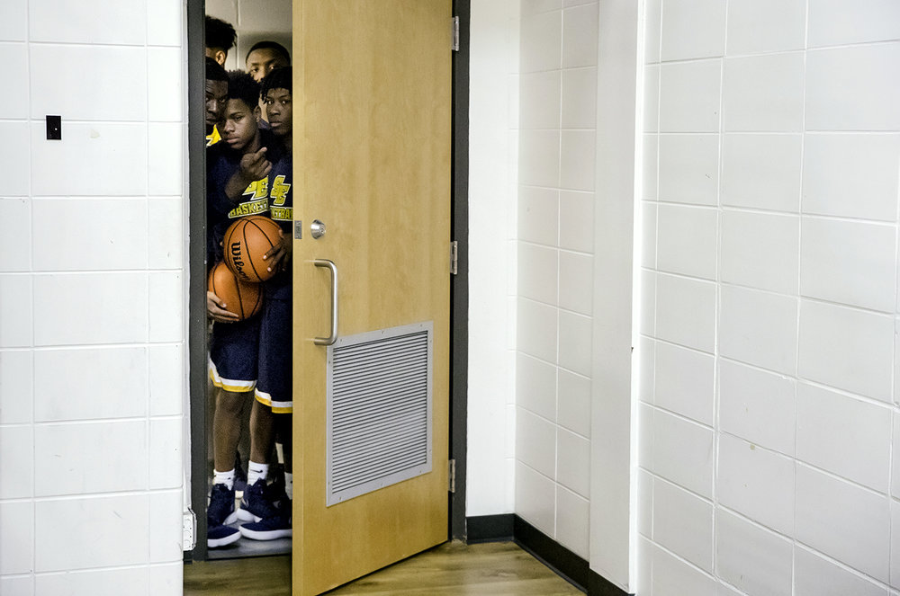 The Southeast Spartans peak out the locker room door before taking on Lanphier during the 3A Decatur Eisenhower Sectional at Decatur Eisenhower High School Friday, March 9, 2018. [Ted Schurter/The State Journal-Register]