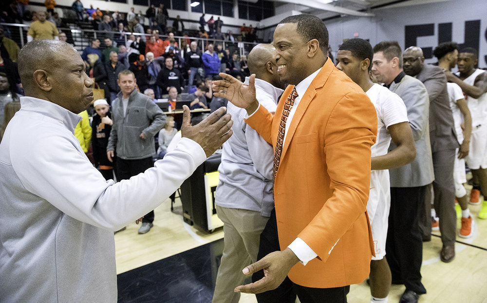 Southeast head coach Lawrence Thomas greets Lanphier head coach Blake Turner after the Spartans defeated the Lions 51-42 during the 3A Decatur Eisenhower Sectional at Decatur Eisenhower High School Friday, March 9, 2018. [Ted Schurter/The State Journal-Register]