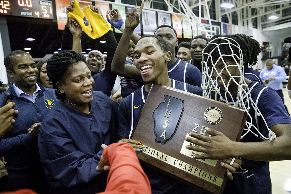 Southeast's Kobe Medley and Stephens Sims celebrate as they bring their new hardware over to the fans after defeating Lanphier 51-42  during the 3A Decatur Eisenhower Sectional at Decatur Eisenhower High School Friday, March 9, 2018. [Ted Schurter/The State Journal-Register]