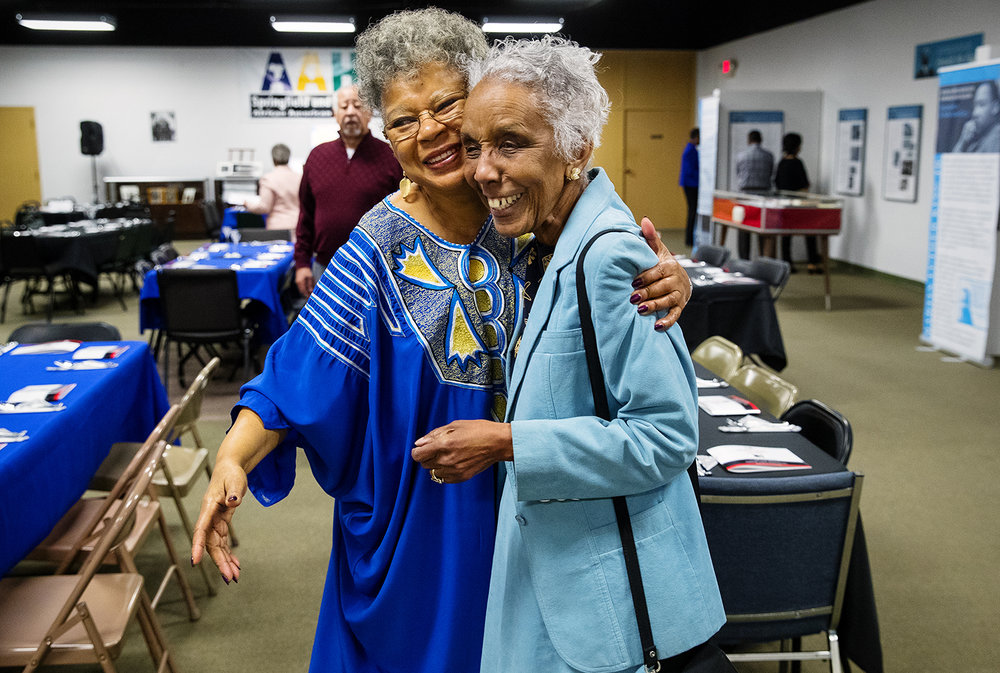Nell Clay, left, president of the board of directors of the Springfield and Central Illinois African American History Museum, greets Theresa Cummings before a ceremony and luncheon for Women's History Month that honored women in Central Illinois who have made sacrifices and contributions during the Civil Rights Movement to end segregation and discrimination at an event at the museum Saturday, March 10, 2018. Cummings was one of the women honored during the event. [Ted Schurter/The State Journal-Register]