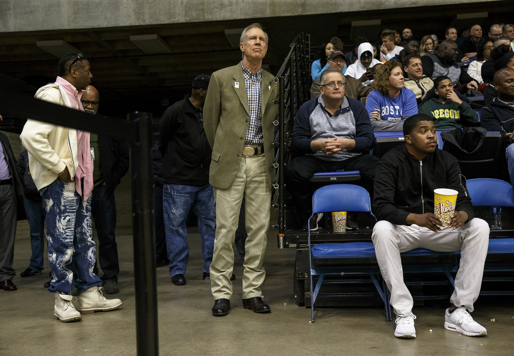 Illinois Gov. Bruce Rauner waits to see the conclusion of the game against Southeast vs. Marion in the second half during the Class 3A Springfield Supersectional at the Bank of Springfield Center, Tuesday, March 13, 2018, in Springfield, Ill. [Justin L. Fowler/The State Journal-Register]