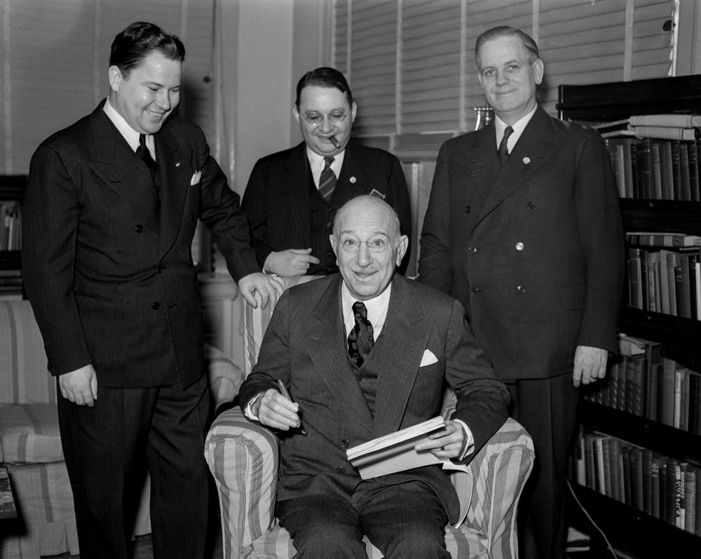 Illinois Gov. Henry Horner and three men in Horner's office. March 17, 1940.