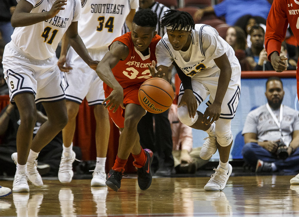 Southeast's Stepheon Sims (32) forces a turnover from North Chicago's DyShawn Gales (32) in the second half during the IHSA Class 3A State Tournament semifinals at Carver Arena, Friday, March 16, 2018, in Peoria, Ill. [Justin L. Fowler/The State Journal-Register]