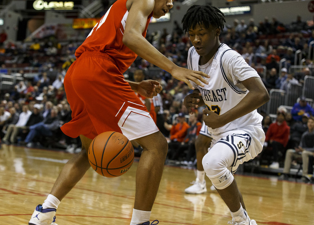 Southeast's Stepheon Sims (32) steals the ball away from North Chicago's Raeshaun Samoa (40) in the first half during the IHSA Class 3A State Tournament semifinals at Carver Arena, Friday, March 16, 2018, in Peoria, Ill. [Justin L. Fowler/The State Journal-Register]