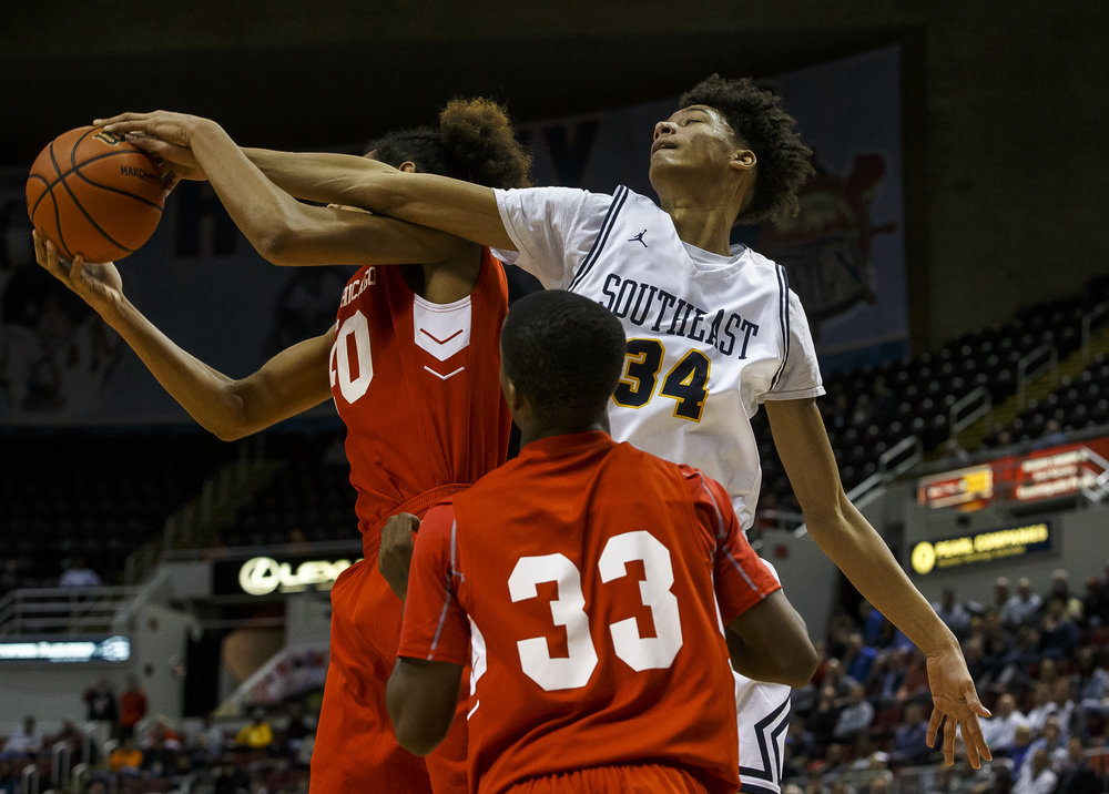 Southeast's Michael Tyler (34) tries to get knock a rebound away from North Chicago's Raeshaun Samoa (40) in the first half during the IHSA Class 3A State Tournament semifinals at Carver Arena, Friday, March 16, 2018, in Peoria, Ill. [Justin L. Fowler/The State Journal-Register]