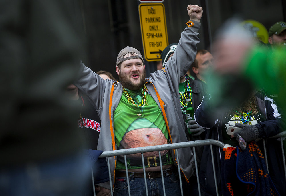 Brad Meyer watches the St. Patrick's Day Parade along Fifth Street Saturday, March 17, 2018  in Springfield, Ill. [Rich Saal/The State Journal-Register]