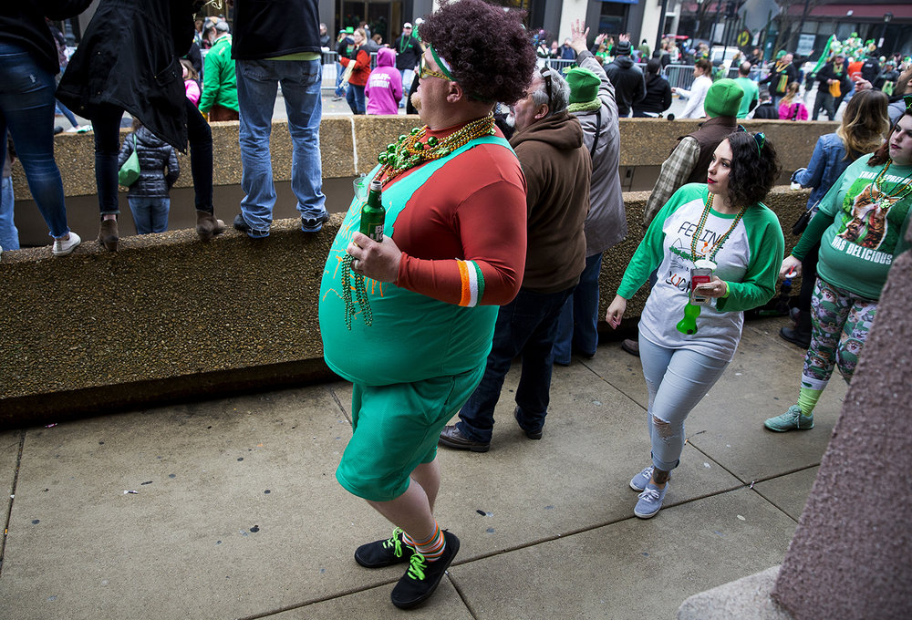 St. Patrick's Day Parade revelers watch from the sidewalk along Fifth Street Saturday, March 17, 2018  in Springfield, Ill. [Rich Saal/The State Journal-Register]