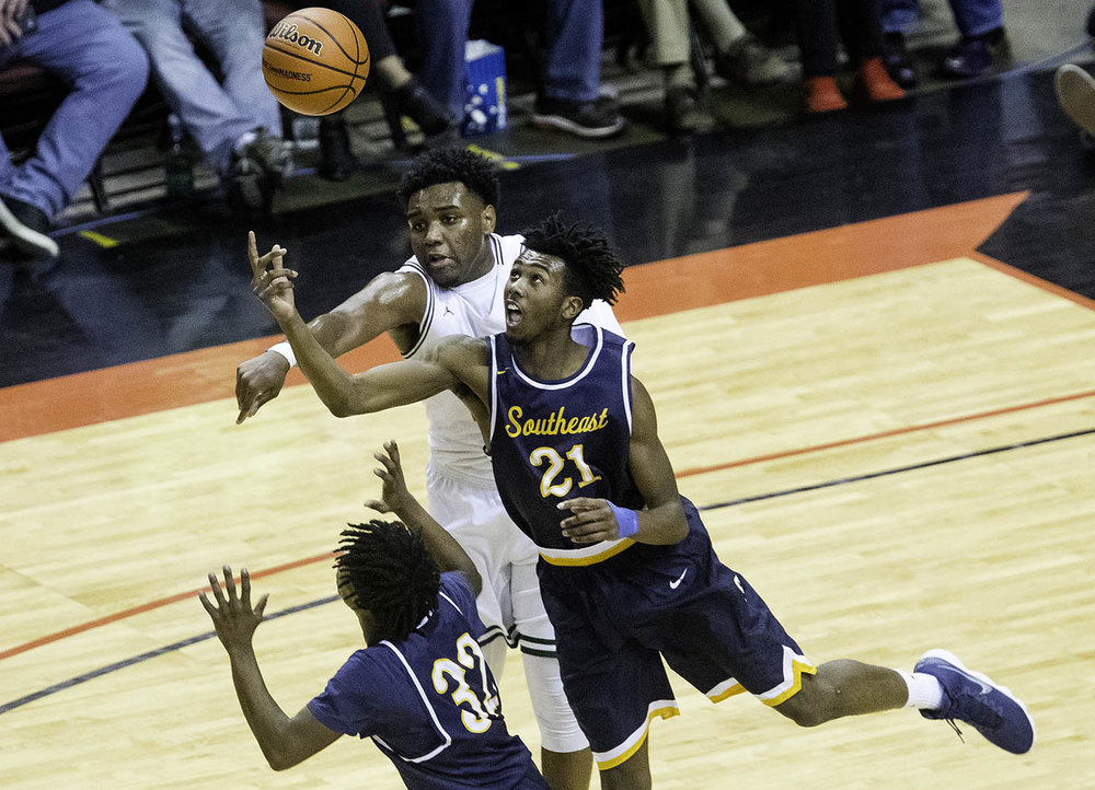 Southeast's Anthony Fairlee tips a rebound his way against Morgan Park  during the 3A championship game at Carver Arena in Peoria, Ill., Saturday, March 17, 2018. [Ted Schurter/The State Journal-Register]