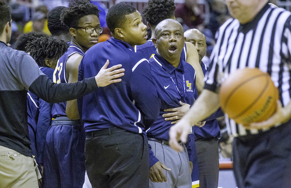 Southeast head coach Lawrence Thomas disagrees with an officials call during the 3A championship game at Carver Arena in Peoria, Ill., Saturday, March 17, 2018. [Ted Schurter/The State Journal-Register]