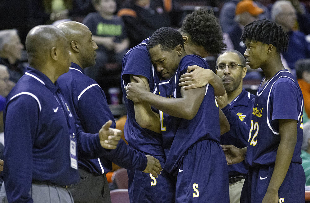 Southeast's Michael Tyler consoles Southeast's Kobe Medley as he takes to the bench in the fourth quarter against Morgan Park  during the 3A championship game at Carver Arena in Peoria, Ill., Saturday, March 17, 2018. [Ted Schurter/The State Journal-Register]