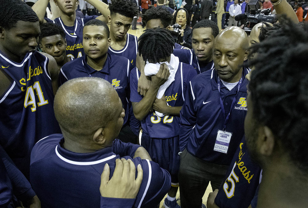 Southeast's Stepheon Sims covers his face as Southeast head coach Lawrence Thomas talks to the Spartans after their loss to Morgan Park  during the 3A championship game at Carver Arena in Peoria, Ill., Saturday, March 17, 2018. [Ted Schurter/The State Journal-Register]