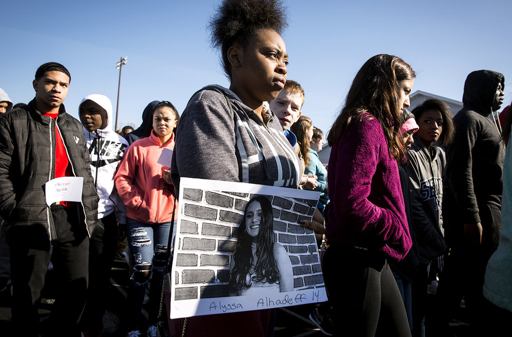 Daniyarieah Lofton, a Southeast High School senior, holds a photograph of Alyssa Alhadeff, a 14-year-old freshman who was shot and killed in the mass shooting at Marjory Stoneman Douglas High School in Parkland, Florida one month ago, during a walkout at Southeast Wednesday, March 14, 2018 in Springfield, Ill. Southeast students and teachers participated in the national demonstration to raise awareness about gun violence in schools. [Rich Saal/The State Journal-Register]