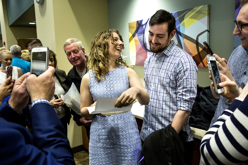 Laura Endris of Springfield, a senior medical student at the Southern Illinois University School of Medicine, learns she'll be staying in Springfield to do her residency in psychiatry after opening her letter on Match Day during an event Friday, March 15, 2018 at the Memorial Center for Learning and Innovation. Endris, who was with her fiance, John Molony, and her family, was one of 68 SIU seniors who, along with other U.S. medical students, learned where they'd be going for their postgraduate training programs as part of the National Resident Matching Program. [Rich Saal/The State Journal-Register]