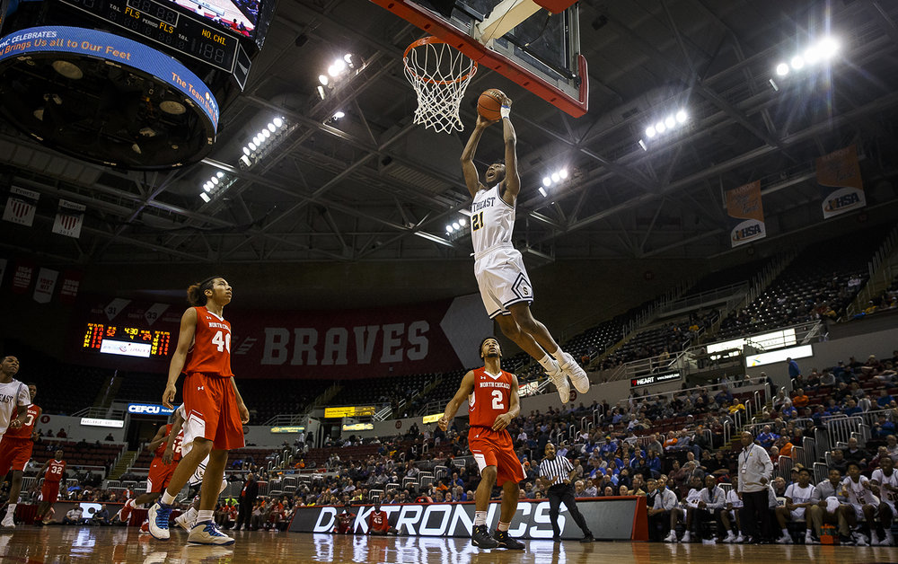 Southeast's Anthony Fairlee (21) soars up to the basket for a dunk against North Chicago in the second half during the IHSA Class 3A State Tournament semifinals at Carver Arena, Friday, March 16, 2018, in Peoria, Ill. [Justin L. Fowler/The State Journal-Register]