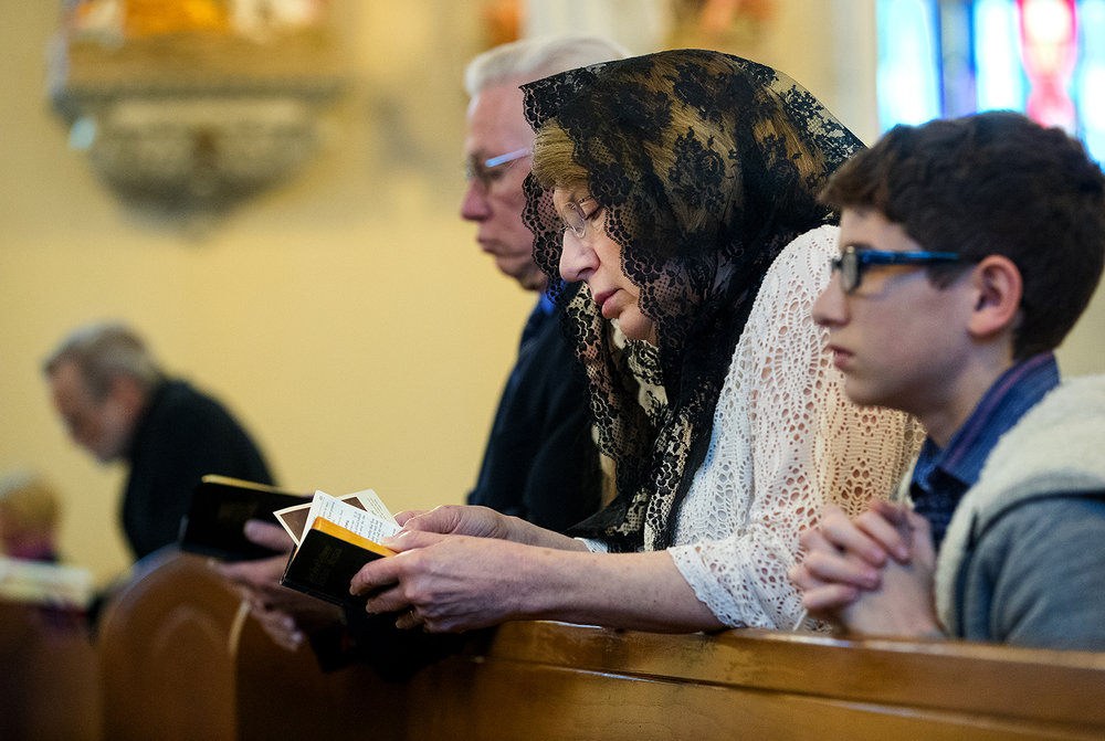 Patricia Daniels of Springfield kneels during the Latin Mass on Easter Sunday at Sacred Heart Church in Springfield, Ill., April 1, 2018. [Ted Schurter/The State Journal-Register]