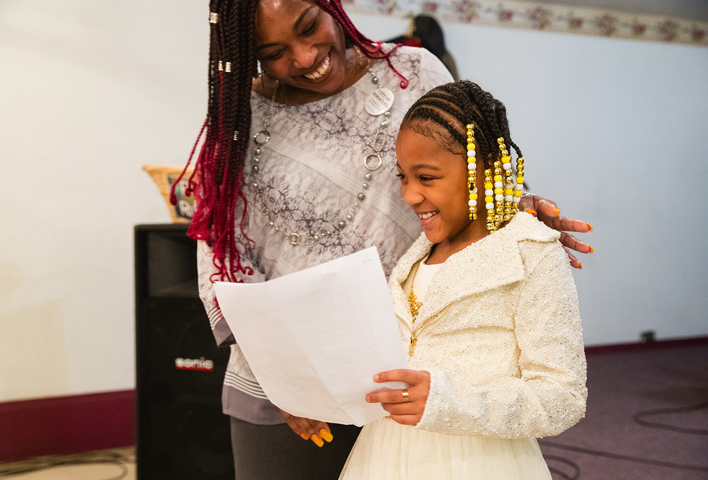 Tondrie Jones congratulates Mialee McCullum after she read an Easter poem aloud during Easter service at City of Miracles International church in Springfield on Easter Sunday, April 1, 2018.  [Ted Schurter/The State Journal-Register]