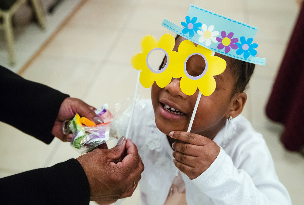 Four-year-old Breasia Jones gets a little help holding up her Easter decorations after Easter service at City of Miracles International church in Springfield on Easter Sunday, April 1, 2018. [Ted Schurter/The State Journal-Register]
