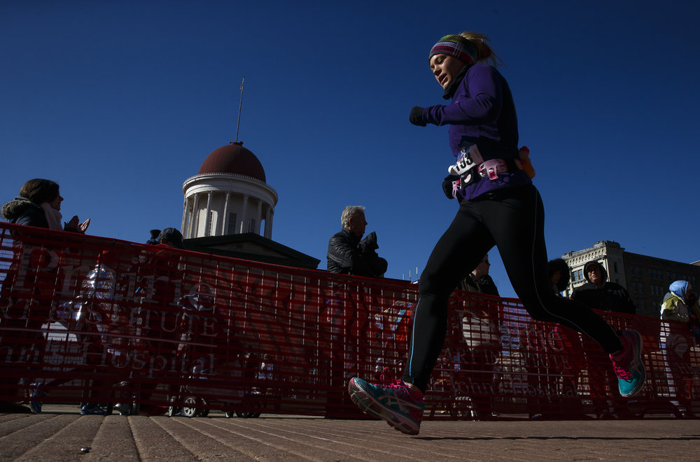 Emily Wilkerson heads towards the finish line in front of the Old State Capitol during the 2018 Lincoln Presidential Half Marathon, Saturday, April 7, 2018, in Springfield, Ill. [Justin L. Fowler/The State Journal-Register]
