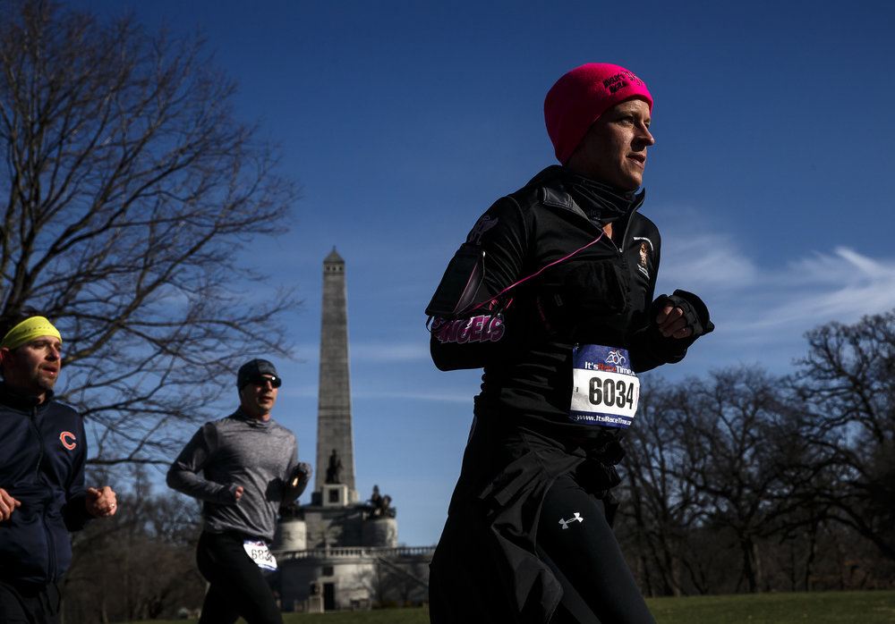 Rachel Antle passes the Lincoln Tomb on her way out of Oak Ridge Cemetery during the 2018 Lincoln Presidential Half Marathon, Saturday, April 7, 2018, in Springfield, Ill. [Justin L. Fowler/The State Journal-Register]