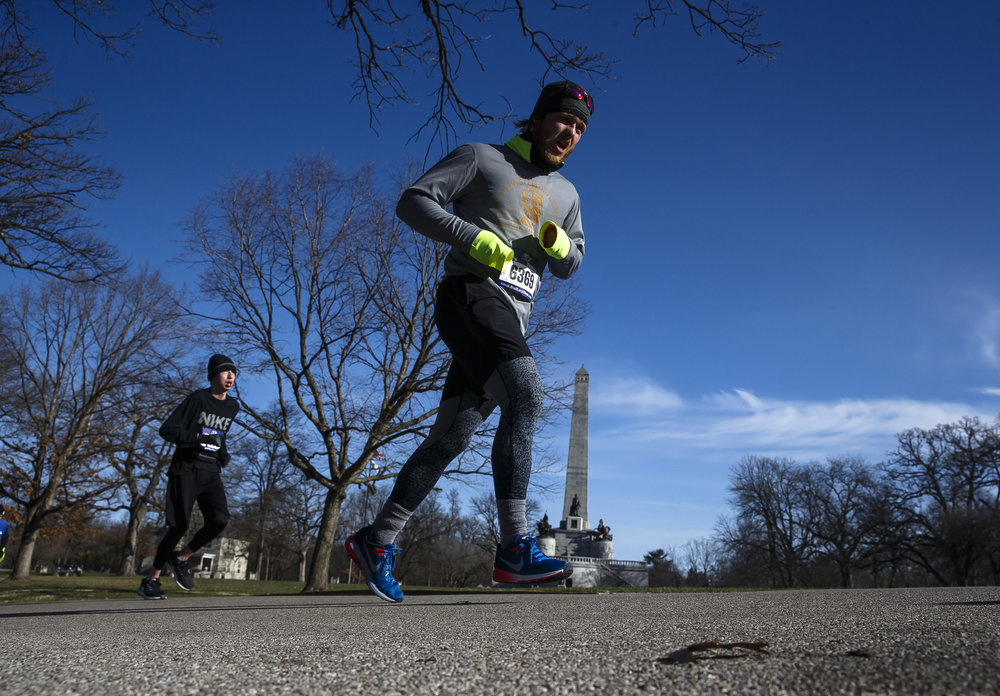 Aaron Gantt powers up the hill as he nears the completion of the loop through Oak Ridge Cemetery near the Lincoln Tomb during the 2018 Lincoln Presidential Half Marathon, Saturday, April 7, 2018, in Springfield, Ill. [Justin L. Fowler/The State Journal-Register]