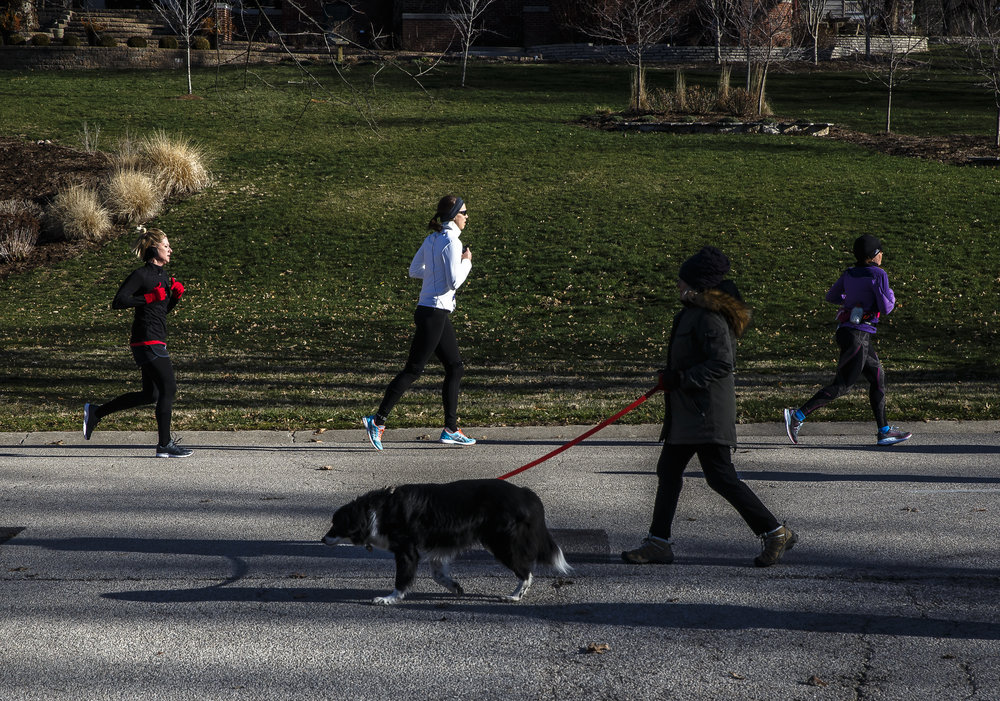 Runners make their way towards Lincoln Avenue out of Washington Park during the 2018 Lincoln Presidential Half Marathon, Saturday, April 7, 2018, in Springfield, Ill. [Justin L. Fowler/The State Journal-Register]