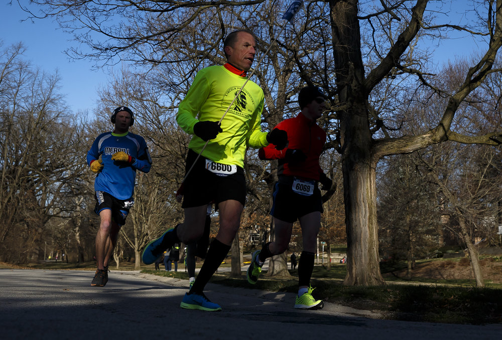 Pacer Steve Koester leads his group out of Washington Park up Lincoln Avenue during the 2018 Lincoln Presidential Half Marathon, Saturday, April 7, 2018, in Springfield, Ill. [Justin L. Fowler/The State Journal-Register]