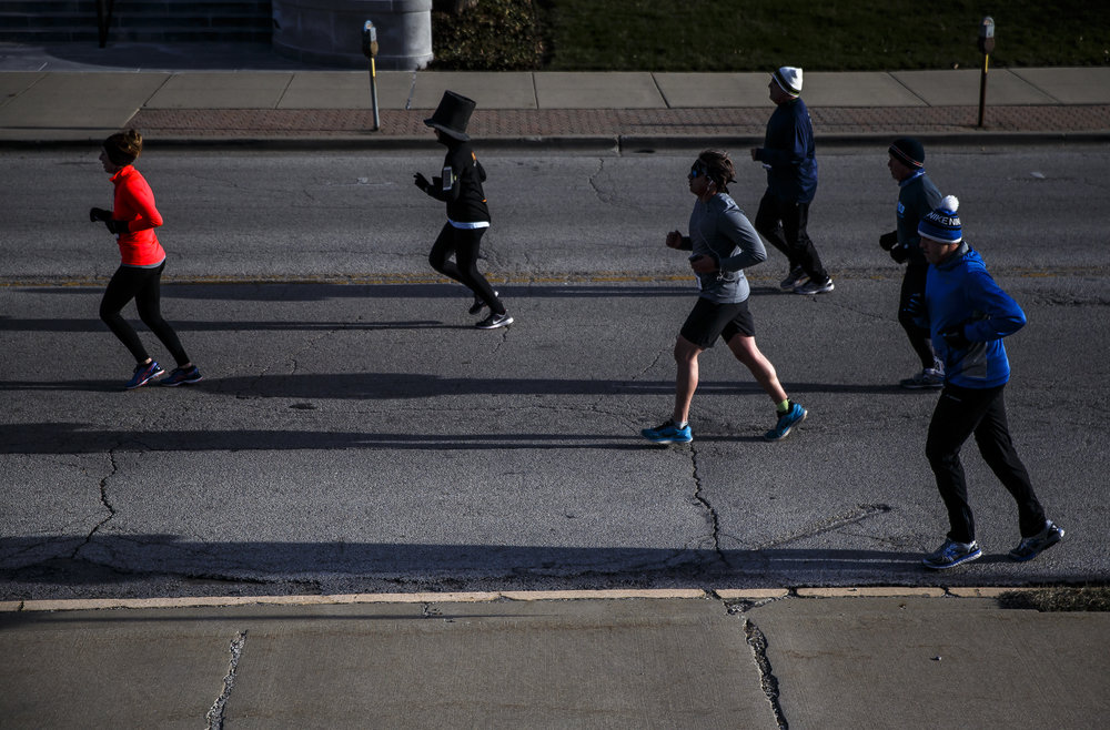 Runners head west on Capital Avenue as they head out of downtown on their way to Washington Park during the 2018 Lincoln Presidential Half Marathon, Saturday, April 7, 2018, in Springfield, Ill. [Justin L. Fowler/The State Journal-Register]
