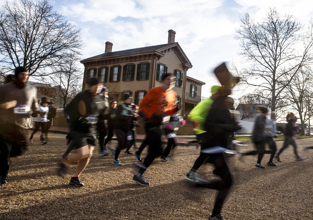 Runners make their way past the Lincoln Home during the 2018 Lincoln Presidential Half Marathon, Saturday, April 7, 2018, in Springfield, Ill. [Justin L. Fowler/The State Journal-Register]