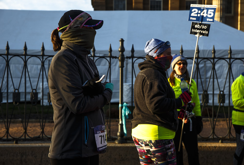 "Jennifer Vanzieleghem, of Rockford Ill., stays bundled up as temperatures hover in the low 20s prior to the start or the 2018 Lincoln Presidential Half Marathon, Saturday, April 7, 2018, in Springfield, Ill. ""I think it's too cold,"" said Vanzieleghem. ""We train all winter in this weather, but when it comes to this race in April it should be a lot warmer."" [Justin L. Fowler/The State Journal-Register]"