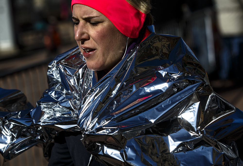 A thermal blanket greeted runners as they hit the finish line with temperatures still in the 20s during the 2018 Lincoln Presidential Half Marathon outside the Old State Capitol, Saturday, April 7, 2018, in Springfield, Ill. [Justin L. Fowler/The State Journal-Register]