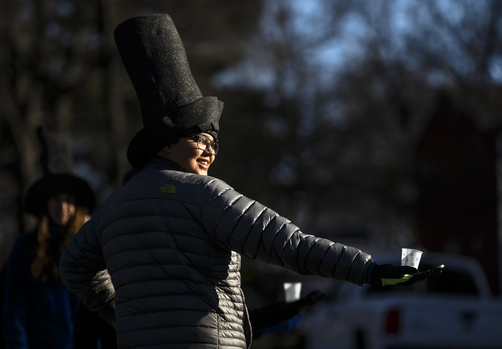 Rafael Anaya, 14, hands out water as the runners head out of Washington Park north on Lincoln Avenue during the 2018 Lincoln Presidential Half Marathon, Saturday, April 7, 2018, in Springfield, Ill. [Justin L. Fowler/The State Journal-Register]