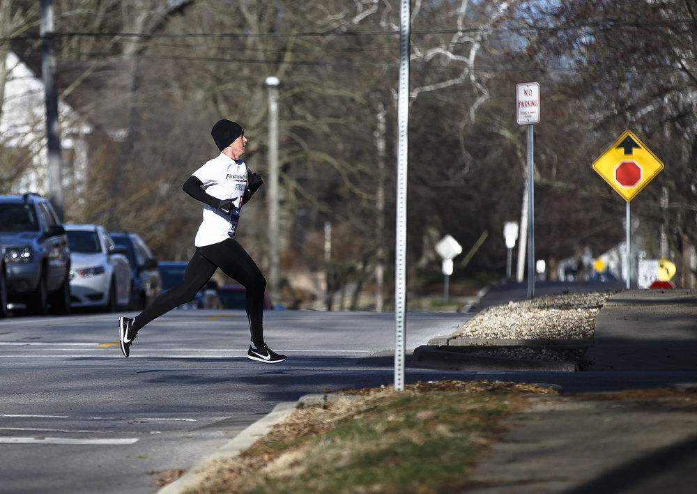Tyler Pence streaks north on Lincoln Avenue out of Washington Park as he leads the pack during the 2018 Lincoln Presidential Half Marathon, Saturday, April 7, 2018, in Springfield, Ill. [Justin L. Fowler/The State Journal-Register]