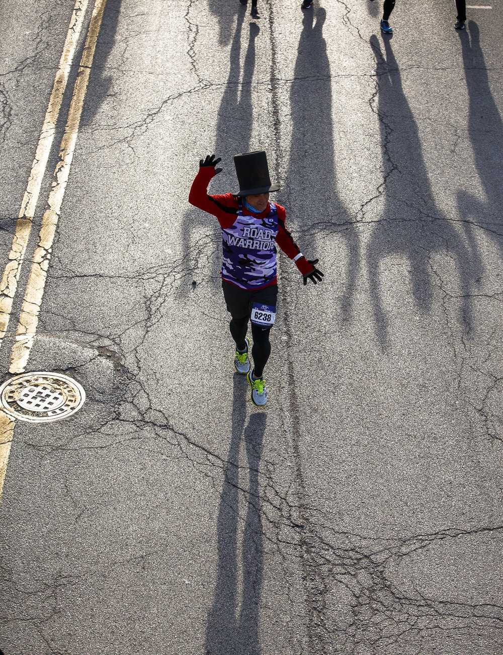 Tommy Dale heads west on Capital Avenue with a top hat keeping his head warm in the 20 degree weather during the 2018 Lincoln Presidential Half Marathon, Saturday, April 7, 2018, in Springfield, Ill. [Justin L. Fowler/The State Journal-Register]