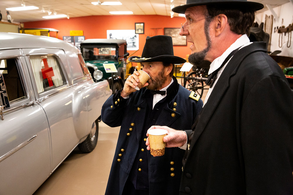 E.C. Fields, Jr., who portrays Gen. Ulysses Grant, and George Buss enjoy a coffee break at the Stephenson County Historical Museum Friday, April 20, 2018 in Freeport, Ill. [Rich Saal/The State Journal-Register]