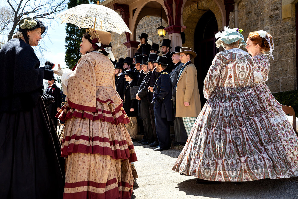 Women who portray Mary Lincoln wait for their turn to be photographed on the steps of the Stephenson County Historical Museum during the Association of Lincoln Presenters convention Friday, April 20, 2018 in Freeport, Ill. [Rich Saal/The State Journal-Register]