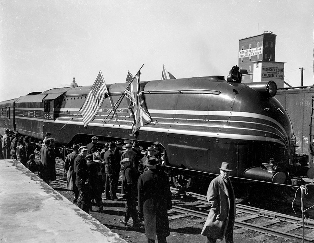 The Coronation Scot, a British-made steam locomotive, toured the United States and made a stop in Springfield, April 1, 1939.  Inaugurated in 1937, it served the express passenger trains of the London, Midland and Scottish Railway between Glasgow and London. At the Alton station, it drew a crowd of 10,000 people who toured the train. It pulled eight cars on a tour of the central U.S., visiting 38 cities in 14 states before returning to the East Coast. It was featured at the New York World's Fair. 