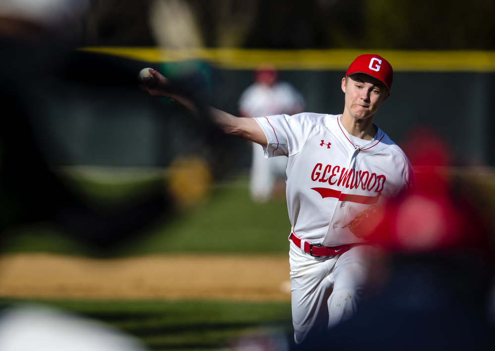 Glenwood's Gavin Wahlbrink winds up for a pitch against the Normal U-High Pioneers Tuesday, April 10, 2018. [Ted Schurter/The State Journal-Register]