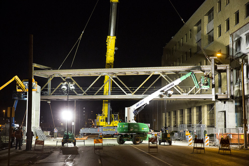 The structural steel frame of a pedestrian sky bridge connecting HSHS St.John's Hospital with an under-construction medical office building was lifted into place over Ninth Street Wednesday, April 11, 2018 in Springfield, Ill. Ninth Street was closed to traffic during the operation, which took 9 hours. Once completed, the enclosed glass structure will stretch 160 feet. [Rich Saal/The State Journal-Register]