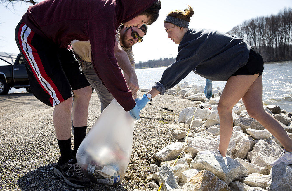 Ian Van Deventer, left, Lee Crank and Haley Simpson collect trash from the shore of Lake Springfield at Marine Point Park Thursday, April 12, 2018 in Springfield, Ill. The environmental studies students sorted, counted and weighed what they found in an effort to determine their impact the Lake Springfield ecosystem. The exercise is part of  UIS Assistant Professor of Environmental Studies Anne-Marie HansonÕs Introduction to Environmental Sciences and Environmental Justice class. [Rich Saal/The State Journal-Register]