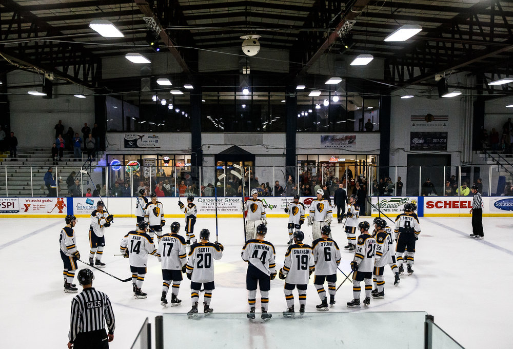 The Springfield Jr. Blues gather at the center of the ice after being defeated 1-0 by the Janesville Jets in the first round of the first-round North American Hockey League playoff series at the Nelson Center, Friday, April 20, 2018, in Springfield, Ill. [Justin L. Fowler/The State Journal-Register]