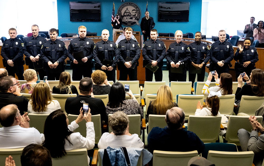 Eleven new Springfield police officers are introduced to their families and guests after Chief Kenny Winslow swore them in during a ceremony in the city council chambers Wednesday, April 18, 2018 in Springfield, Ill. One of the larger classes of new hires, according to Winslow, theyÕll each complete an additional 20-week field training program with veteran officers. The new class includes, from left, Timothy Zock, Taylor Staff, Christopher Snodgrass, Cody Sands, Justin Long-Croteau, James Foxx, Kyle Duval, Monica Dorsey, Timara Blair, Wesley Alvey and Ajibola JÕnae Agbenla. [Rich Saal/The State Journal-Register]