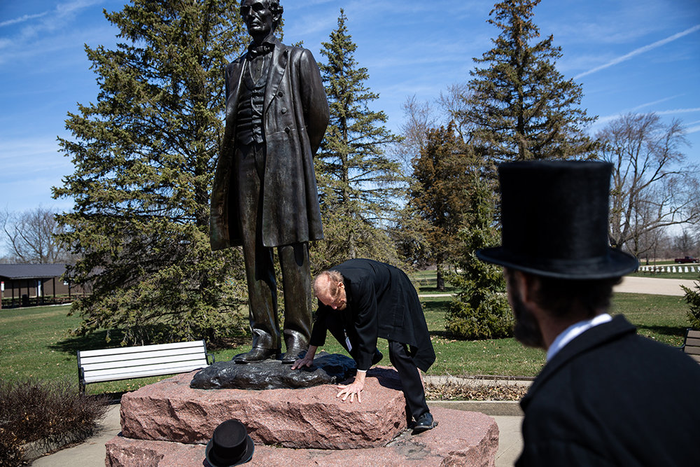 Roger Vincent steps down from a Lincoln Statue in Taylor Park after having his picture made Friday, April 20, 2018, in Freeport, Ill. [Rich Saal/The State Journal-Register]
